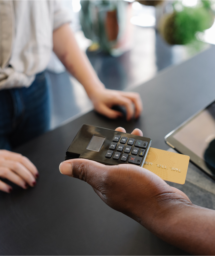 Image of credit card scanner with person holding it
